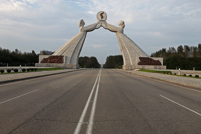 In Pyongyang, a symbol of reunification of the Korean peninsula. At the base of the structure are messages of support from various individuals, organizations and nations for re-unification and peace. The monument depicts two Korean women in traditional dress, with their arms stretched out trying to embrace one another and shout 'long live reunification.' Each woman represents the idea that the North and South are the same nation living in the same territory with the same mind, but are unfortunately divided.