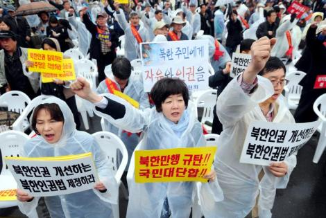 South Korean protestors shout slogans during a rally against North Korea's regime in Seoul on April 26. The placards read 'Freedom and human rights for North Korean people.' (Ji-Hwan/AFP/Getty Images)